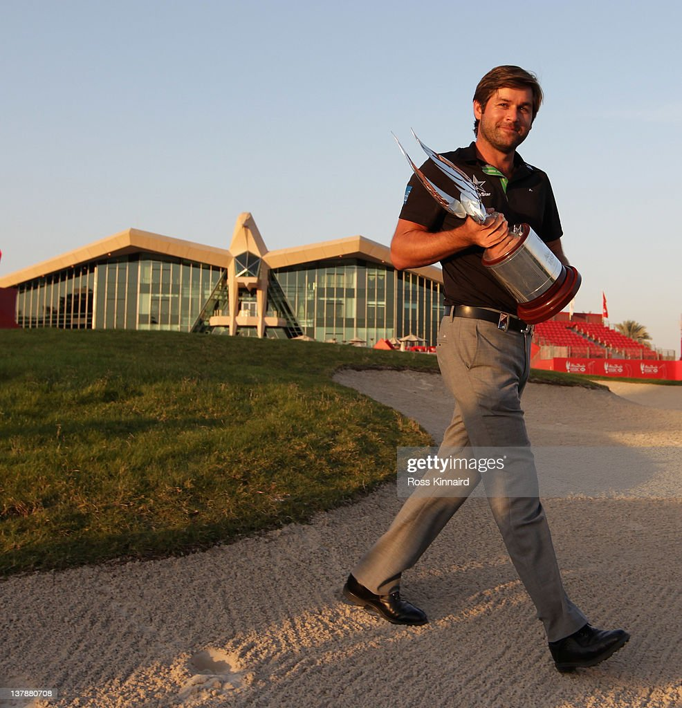 <a gi-track='captionPersonalityLinkClicked' href=/galleries/search?phrase=Robert+Rock&family=editorial&specificpeople=228315 ng-click='$event.stopPropagation()'>Robert Rock</a> of England with the Champions trophy after winning the Abu Dhabi HSBC Golf Championship at the Abu Dhabi HSBC Golf Championship on January 29, 2012 in Abu Dhabi, United Arab Emirates.