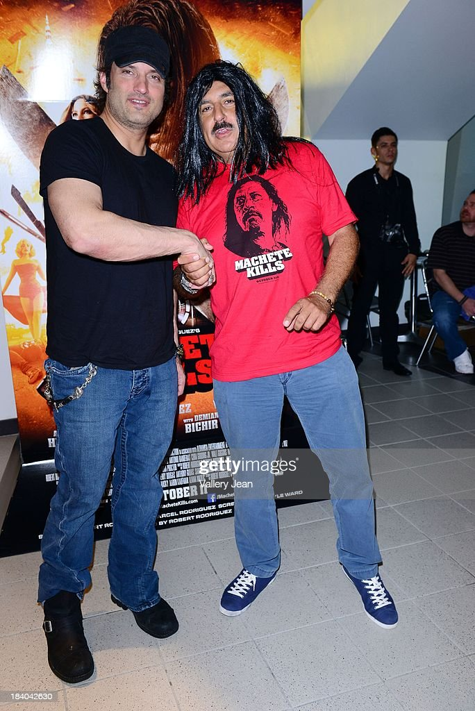 Robert Rodriguez and Fernando Fiore attend 'Machete Kills' red carpet premiere at Regal South Beach on October 10, 2013 in Miami, Florida.