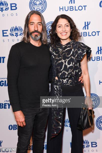 Robert Russell and Lisa Edelstein attend Photo Op For Hulu's 'Obey Giant' at The Theatre at Ace Hotel on November 7 2017 in Los Angeles California