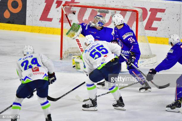 Robert Sabolic of Slovenia beats goalkeeper Ronan Quemener of France to score during the EIHF Ice Hockey Four Nations tournament match between France...