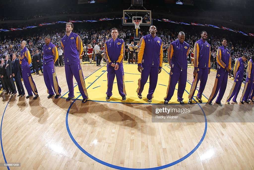 Robert Sacre #50, Metta World Peace #15, Pau Gasol #16, Steve Nash #10, Kobe Bryant #24, Jodie Meeks #20, Earl Clark #6, Devin Ebanks #3, and Darius Morris #1 of the Los Angeles Lakers in a game against the Golden State Warriors on December 22, 2012 at Oracle Arena in Oakland, California.