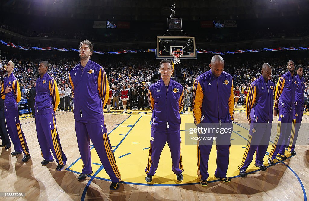 Robert Sacre #50, Metta World Peace #15, Pau Gasol #16, Steve Nash #10, Kobe Bryant #24, Jodie Meeks #20, Earl Clark #6 and Devin Ebanks #3 of the Los Angeles Lakers in a game against the Golden State Warriors on December 22, 2012 at Oracle Arena in Oakland, California.