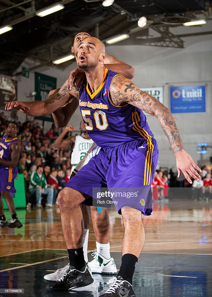 Robert Sacre #50 of the Los Angeles D-Fenders boxes out Fab Melo #41 of the Maine Red Claws on November 30, 2012 at the Portland Expo in Portland, Maine.