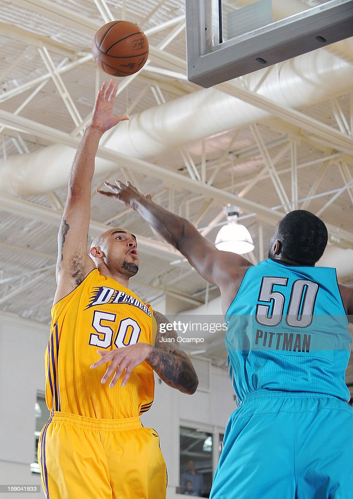 Robert Sacre #50 of the Los Angeles D-Fenders shoots over Dexter Pittman #50 of the Sioux Falls Skyforce on January 5, 2013 at Toyota Sports Center in El Segundo, California.