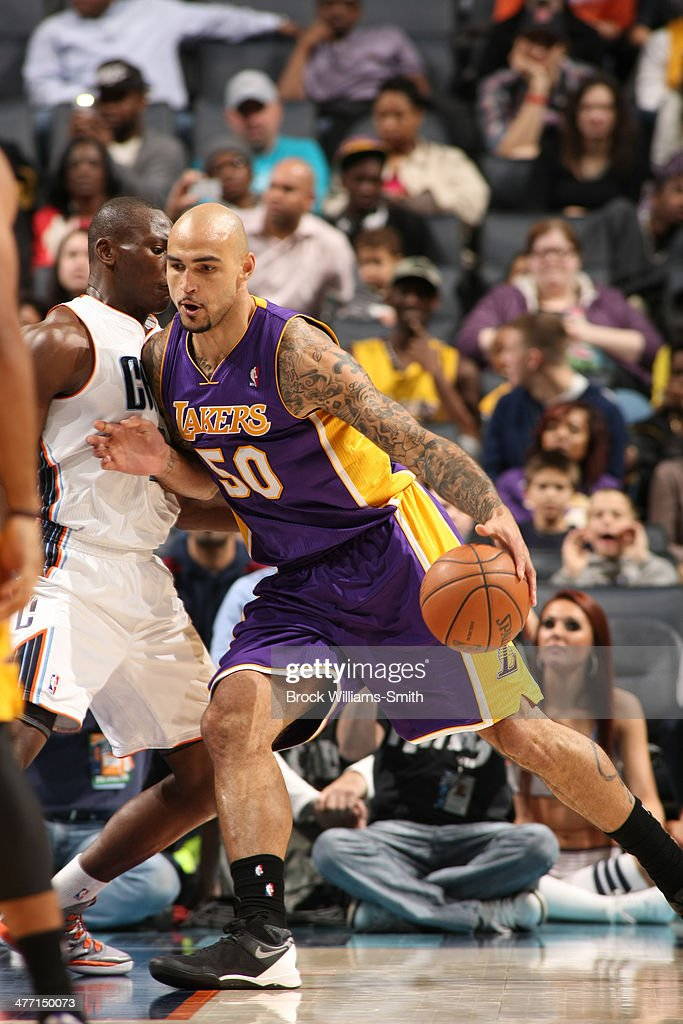 <a gi-track='captionPersonalityLinkClicked' href=/galleries/search?phrase=Robert+Sacre&family=editorial&specificpeople=4682421 ng-click='$event.stopPropagation()'>Robert Sacre</a> #50 of the Los Angeles Lakers dribbles to the basket against the Charlotte Bobcats during the game at the Time Warner Cable Arena on December 14, 2013 in Charlotte, North Carolina.