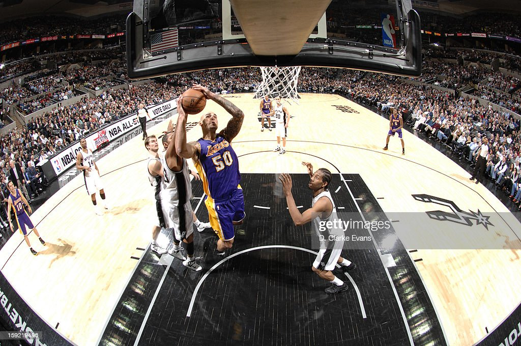 <a gi-track='captionPersonalityLinkClicked' href=/galleries/search?phrase=Robert+Sacre&family=editorial&specificpeople=4682421 ng-click='$event.stopPropagation()'>Robert Sacre</a> #50 of the Los Angeles Lakers goes to the basket during the game between the Los Angeles Lakers and the San Antonio Spurs on January 9, 2013 at the AT&T Center in San Antonio, Texas.