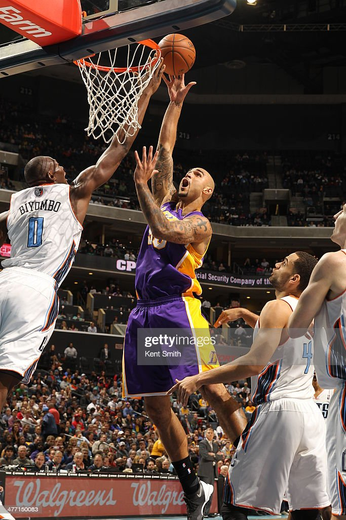 <a gi-track='captionPersonalityLinkClicked' href=/galleries/search?phrase=Robert+Sacre&family=editorial&specificpeople=4682421 ng-click='$event.stopPropagation()'>Robert Sacre</a> #50 of the Los Angeles Lakers goes up for the shot against the Charlotte Bobcats during the game at the Time Warner Cable Arena on December 14, 2013 in Charlotte, North Carolina.