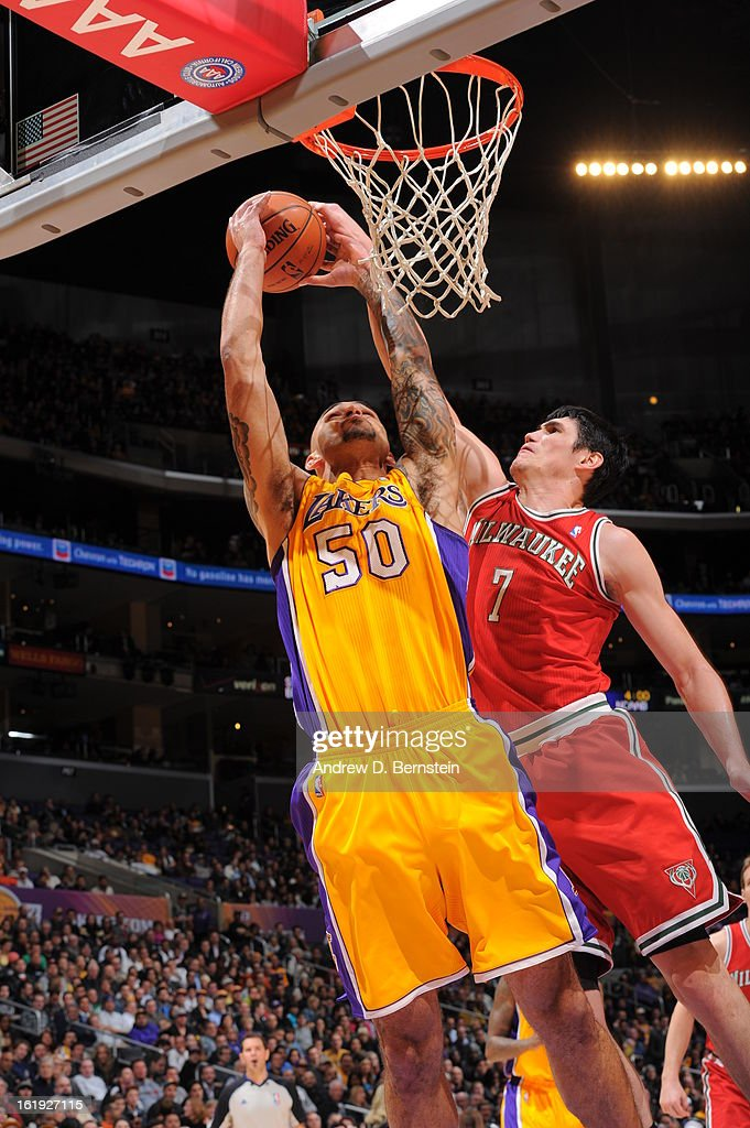 <a gi-track='captionPersonalityLinkClicked' href=/galleries/search?phrase=Robert+Sacre&family=editorial&specificpeople=4682421 ng-click='$event.stopPropagation()'>Robert Sacre</a> #50 of the los Angeles Lakers goes up strong to the hoop against <a gi-track='captionPersonalityLinkClicked' href=/galleries/search?phrase=Ersan+Ilyasova&family=editorial&specificpeople=557070 ng-click='$event.stopPropagation()'>Ersan Ilyasova</a> #7 of the Milwaukee Bucks at Staples Center on January 15, 2013 in Los Angeles, California.