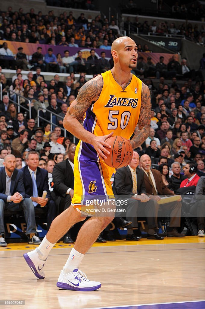 <a gi-track='captionPersonalityLinkClicked' href=/galleries/search?phrase=Robert+Sacre&family=editorial&specificpeople=4682421 ng-click='$event.stopPropagation()'>Robert Sacre</a> #50 of the Los Angeles Lakers looks to pass the ball against the Milwaukee Bucks at Staples Center on January 15, 2013 in Los Angeles, California.