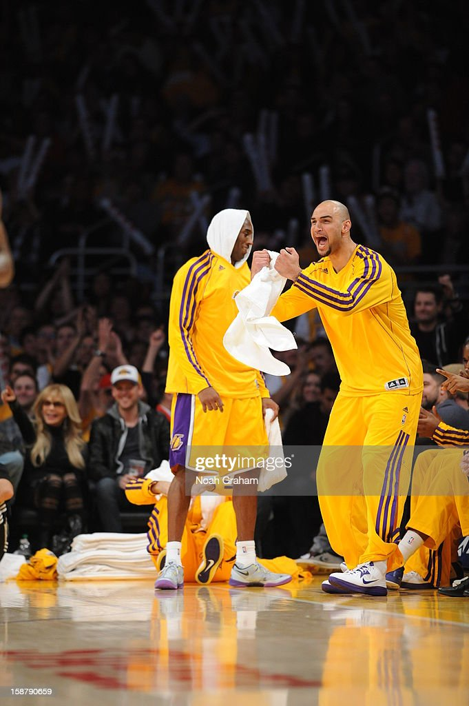 Robert Sacre #50 of the Los Angeles Lakers reacts during a game against the Portland Trail Blazers at Staples Center on December 28, 2012 in Los Angeles, California.