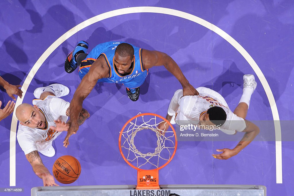 <a gi-track='captionPersonalityLinkClicked' href=/galleries/search?phrase=Robert+Sacre&family=editorial&specificpeople=4682421 ng-click='$event.stopPropagation()'>Robert Sacre</a> #50 of the Los Angeles Lakers rebounds against the Oklahoma City Thunder at STAPLES Center on March 9, 2014 in Los Angeles, California.