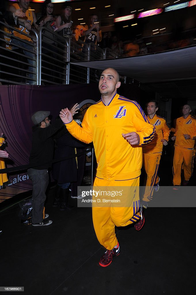 <a gi-track='captionPersonalityLinkClicked' href=/galleries/search?phrase=Robert+Sacre&family=editorial&specificpeople=4682421 ng-click='$event.stopPropagation()'>Robert Sacre</a> #50 of the Los Angeles Lakers shakes hands with people prior to the game against the Los Angeles Clippers at Staples Center on February 14, 2013 in Los Angeles, California.
