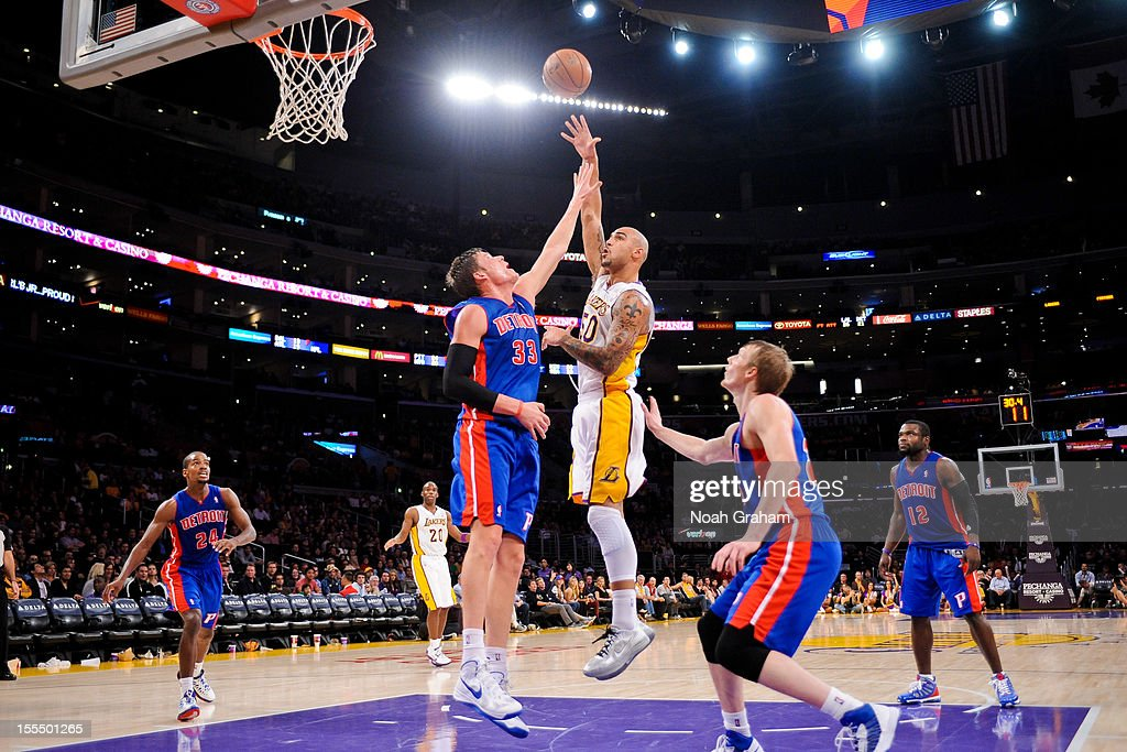 <a gi-track='captionPersonalityLinkClicked' href=/galleries/search?phrase=Robert+Sacre&family=editorial&specificpeople=4682421 ng-click='$event.stopPropagation()'>Robert Sacre</a> #50 of the Los Angeles Lakers shoots against <a gi-track='captionPersonalityLinkClicked' href=/galleries/search?phrase=Jonas+Jerebko&family=editorial&specificpeople=5942357 ng-click='$event.stopPropagation()'>Jonas Jerebko</a> #33 of the Detroit Pistons at Staples Center on November 4, 2012 in Los Angeles, California.