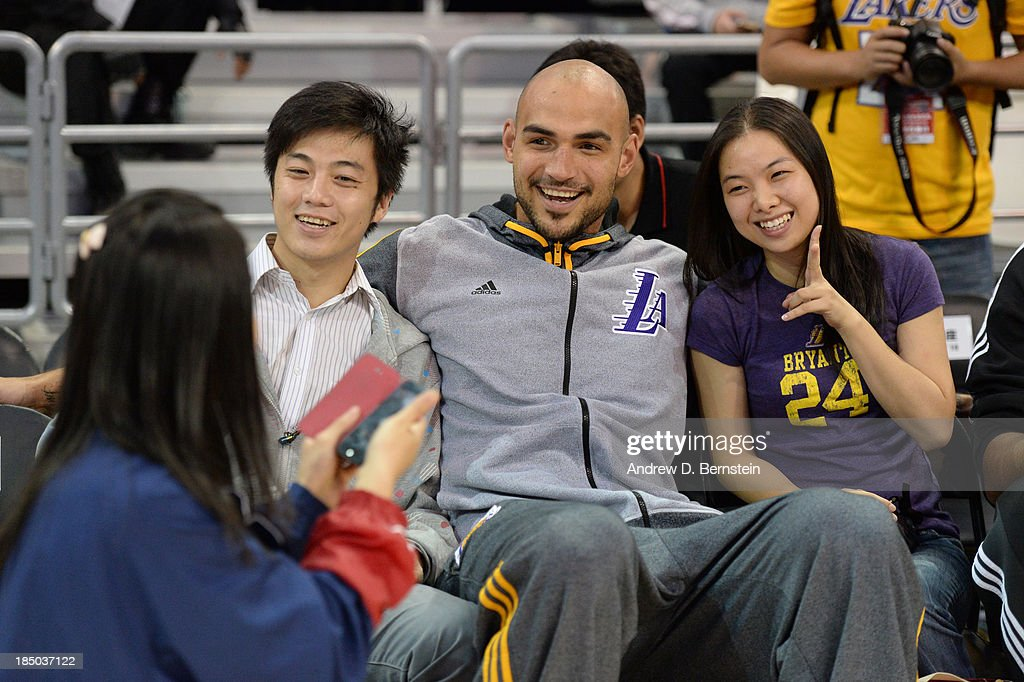 Robert Sacre of the Los Angeles Lakers takes photos with some fans during Fan Appreciation Day as part of the 2013 Global Games on October 17, 2013 at the Oriental Sports Center in Shanghai, China.