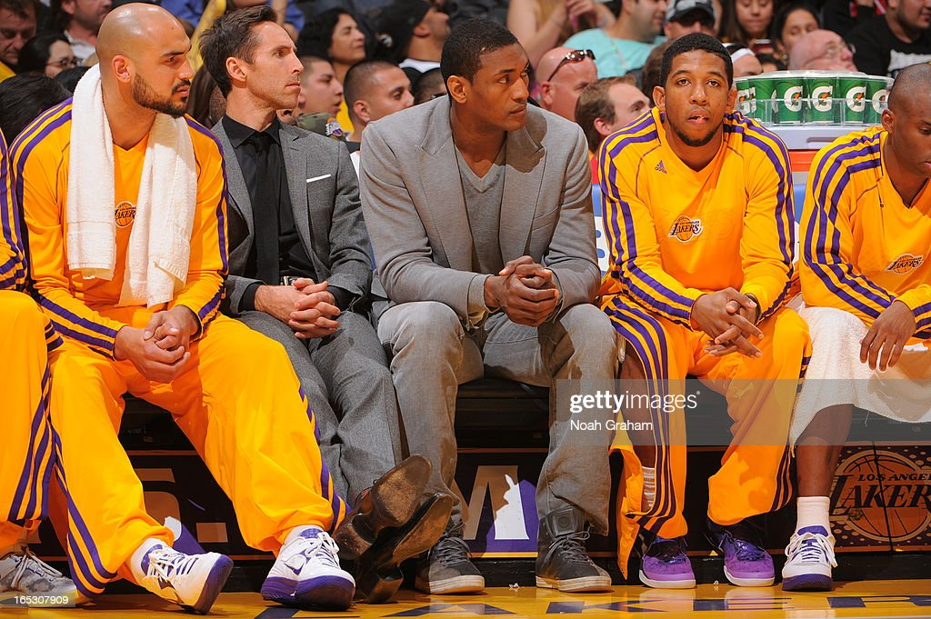 Robert Sacre #50, Steve Nash #10, Metta World Peace #15, Darius Morris #1, and Jodie Meeks #20 of the Los Angeles Lakers look on from the bench in their game against the Dallas Mavericks at Staples Center on April 2, 2013 in Los Angeles, California.