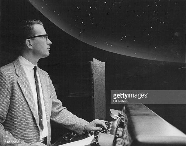 SEP 16 1963 SEP 18 1963 Robert Samples instructor operates Planetarium equipment while 'stars' shine overhead
