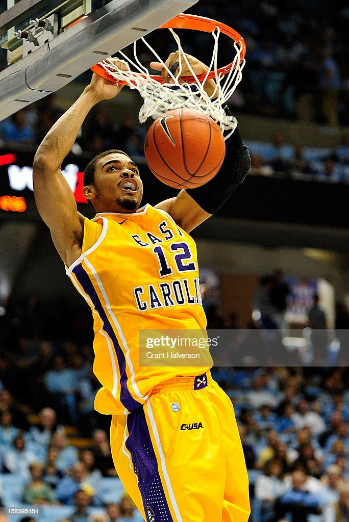 Robert Sampson #12 of the East Carolina Pirates dunks against the North Carolina Tar Heels during play at the Dean Smith Center on December 15, 2012 in Chapel Hill, North Carolina.