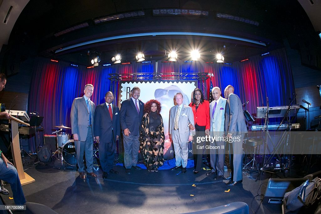 Robert Santelli (Executive Director, The Grammy Museum), Mark Ridley-Thomas (Los Angeles County Supervisor), Jesse Jackson, <a gi-track='captionPersonalityLinkClicked' href=/galleries/search?phrase=Chaka+Khan&family=editorial&specificpeople=208691 ng-click='$event.stopPropagation()'>Chaka Khan</a>, Cliff Rucker (Vice President of Sales, U.S.Postal Service), Valerie Ervin (President, Ray Charles Foundation), <a gi-track='captionPersonalityLinkClicked' href=/galleries/search?phrase=Joe+Adams&family=editorial&specificpeople=1301884 ng-click='$event.stopPropagation()'>Joe Adams</a> (Manager and Friend of Ray Charles) and Ray Charles Robinson Jr (Son of Ray Charles), pose for a photo at the U.S. Postal Service First Day Of Issue Ceremony for the Ray Charles Forever Stamp at The GRAMMY Museum on September 23, 2013 in Los Angeles, California.