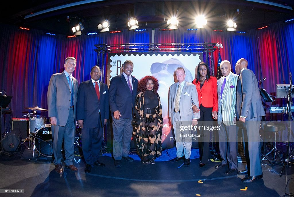 Robert Santelli, Mark Ridley-Thomas, Jesse Jackson, Chaka Khan, Cliff Rucker, Valerie Ervin, Joe Adams and Ray Charles Jr. pose for a photo at the U.S. Postal Service First Day Of Issue Ceremony for the Ray Charles Forever Stamp at The GRAMMY Museum on September 23, 2013 in Los Angeles, California.
