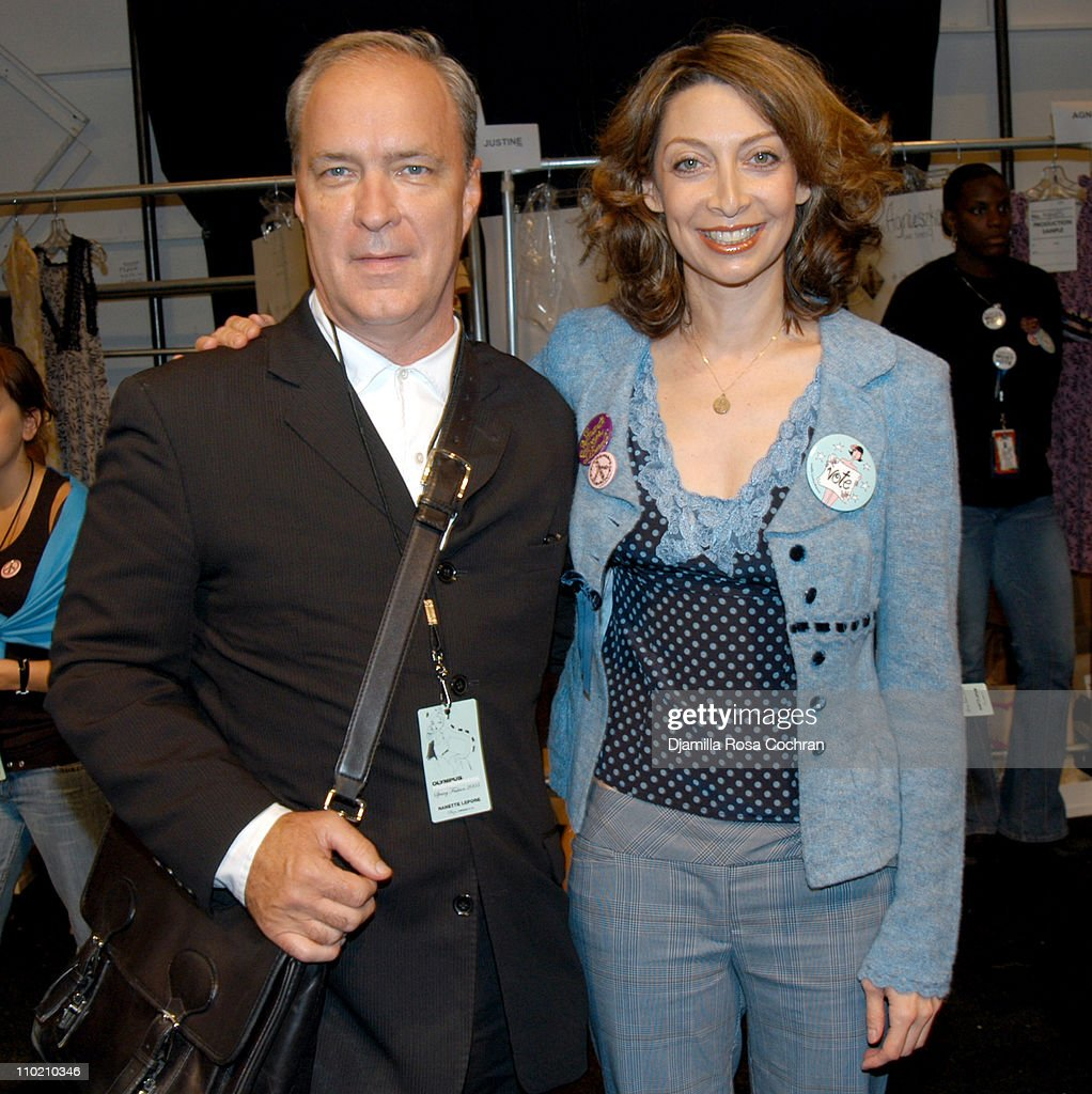 Robert Savage and Illeana Douglas during Olympus Fashion Week Spring 2005 - Nanette Lepore - Front Row and Backstage at Plaza Tent, Bryant Park in New York City, New York, United States.
