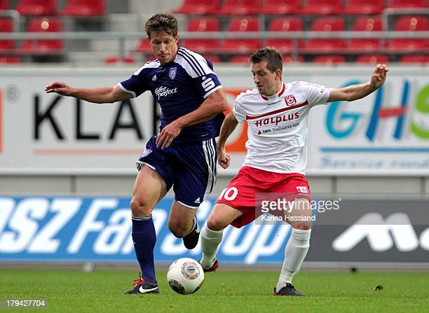 Robert Schick of Halle and Sebastian Neumann of Osnabrueck battle for the ball during the 3rd Liga match between Hallescher FC and VfL Osnabrueck at...