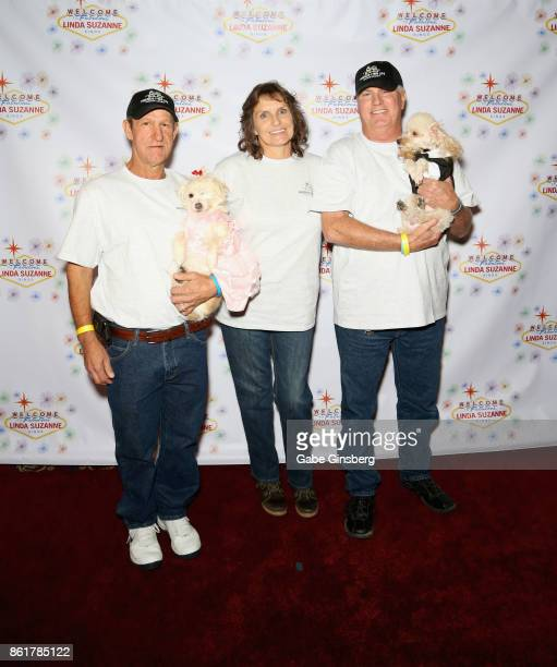 Robert Schrader Lynette Nelson and Ron Waters pose with rescue dogs that they brought from Friends for Life Humane Society at the debut of 'Linda...