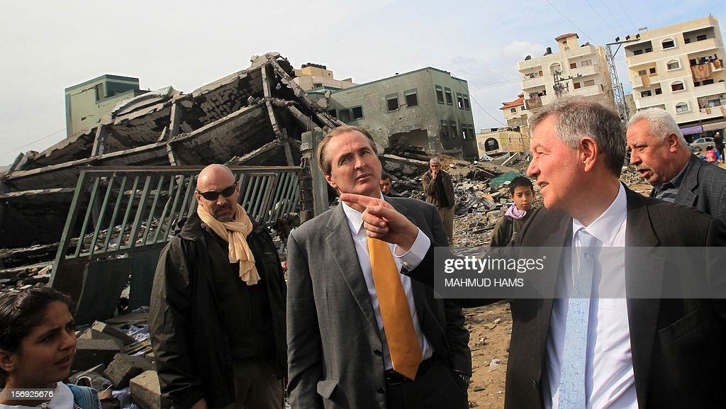 Robert Serry (R), the United Nations Special Coordinator for the Middle East Peace Process, points during a visit to survey the damage cause by the Israeli bombardment of the Gaza Strip in retaliation to Hamas rocket attacks on Israel, on November 25, 2012, in Gaza City, four days following a truce between Israel and the ruling Hamas movement in Gaza. AFP PHOTO/MAHMUD HAMS