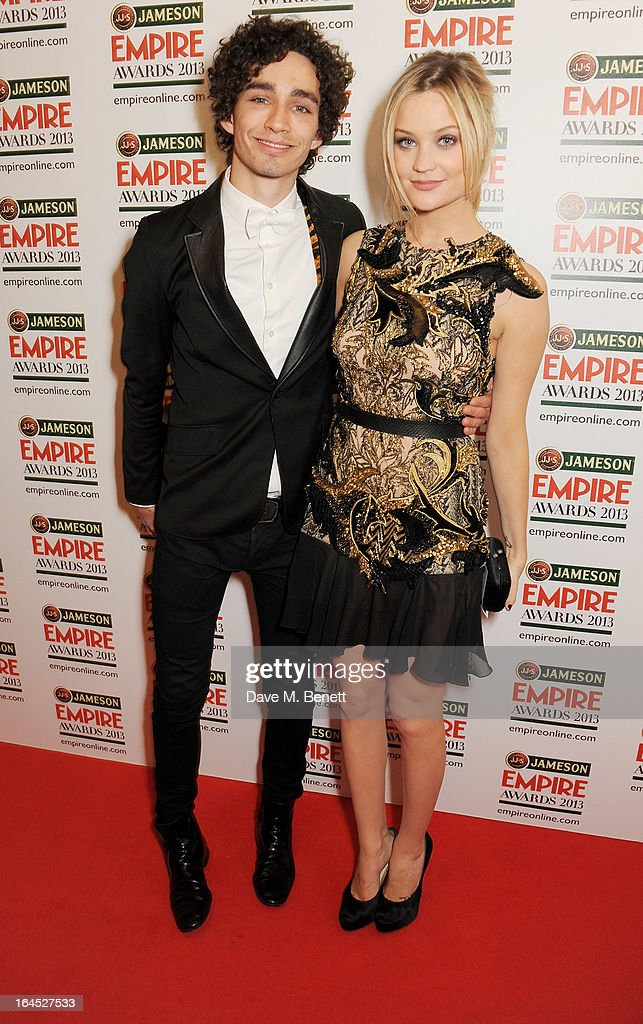 Robert Sheehan (L) and Laura Whitmore pose in the press room at the Jameson Empire Awards 2013 at The Grosvenor House Hotel on March 24, 2013 in London, England.
