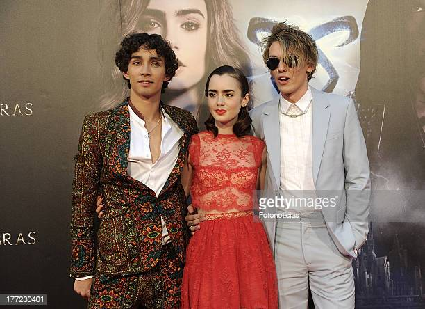Robert Sheehan Lily Collins and Jamie Campbell Bower attend the premiere of 'The Mortal Instruments City Of Bones' at Callao Cinema on August 22 2013...