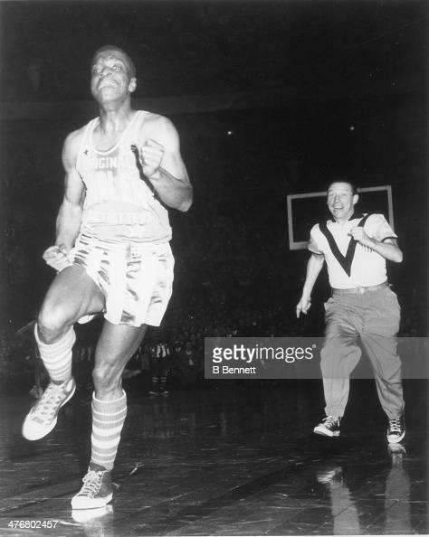 Robert 'Showboat' Hall of the Harlem Globetrotters runs away from referee Pat Kennedy during an exhibition game against the Philadelphia Sphas circa...