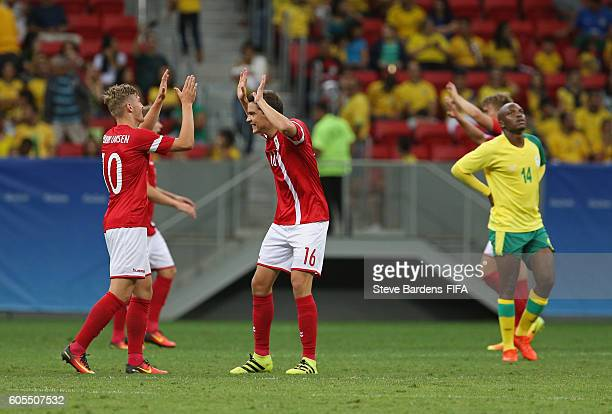 Robert Skov and Jacob Bruun Larsen of Denmark celebrate their victory over South Africa during the Men's First Round Group A match between Denmark...