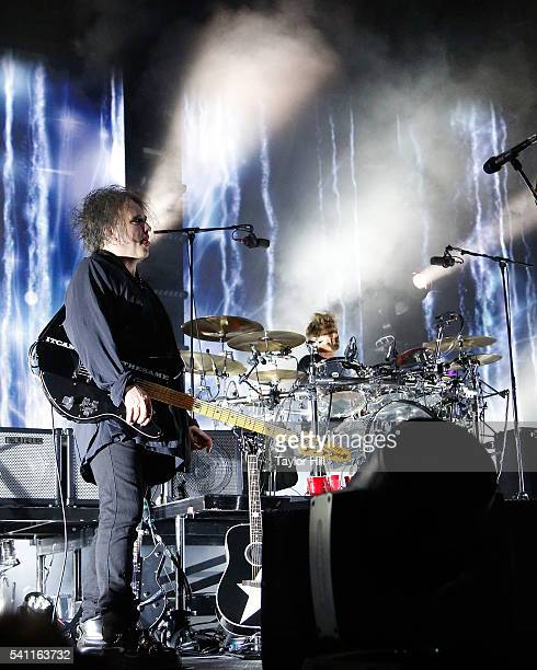 Robert Smith and Jason Cooper of The Cure perform at Madison Square Garden on June 18 2016 in New York City