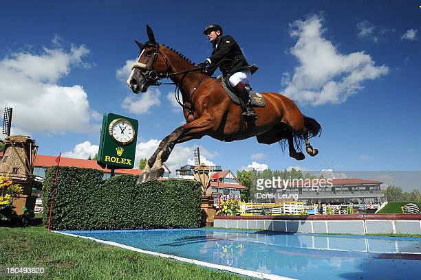 Robert Smith of Great Britain riding Voila competes in the individual jumping equestrian on the final day of the Masters tournament at Spruce Meadows...