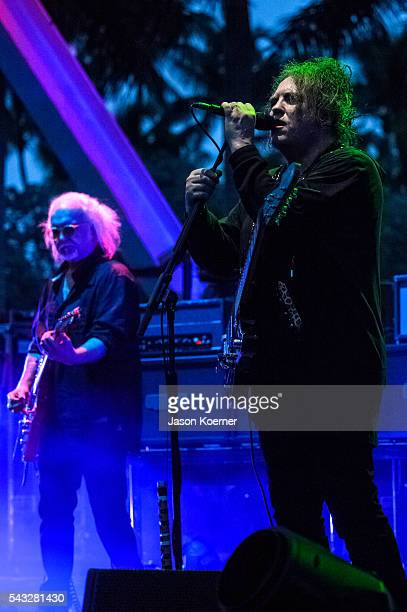 Robert Smith Reeves Gabrels of The Cure perform at Bayfront Park Amphitheater on June 26 2016 in Miami Florida