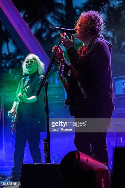 Robert Smith Reeves Grabels of The Cure perform at Bayfront Park Amphitheater on June 26 2016 in Miami Florida