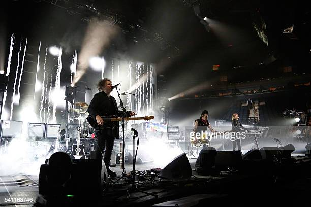 Robert Smith Simon Gallup and Roger O'Donnell of The Cure perform at Madison Square Garden on June 18 2016 in New York City