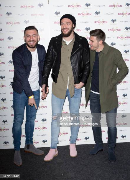 Robert Snodgrass Andy Carroll and Aaron Cresswell arriving at the Mile End Genesis cinema in London for the premiere of Iron Men a documentary about...