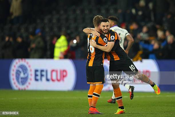 Robert Snodgrass of Hull City celebrates with Josh Tymon after the penalty shoot out victory during the at EFL Cup QuarterFinal match between Hull...