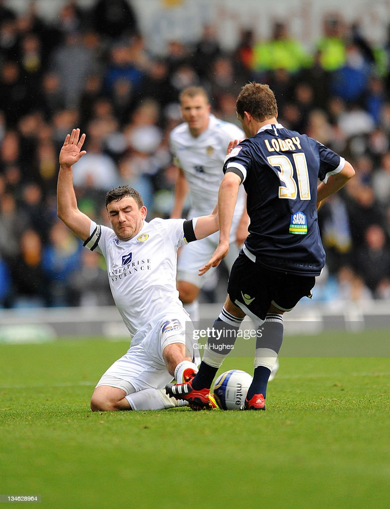 Robert Snodgrass (left) of Leeds tackles Shane lowry of Millwalll during the npower Championship match between Leeds United and Millwall at Elland Road on December 03, 2011 in Leeds, England.