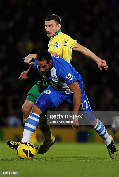 Robert Snodgrass of Norwich City battles with Jean Beausejour of Wigan during the Barclays Premier League match between Norwich City and Wigan...