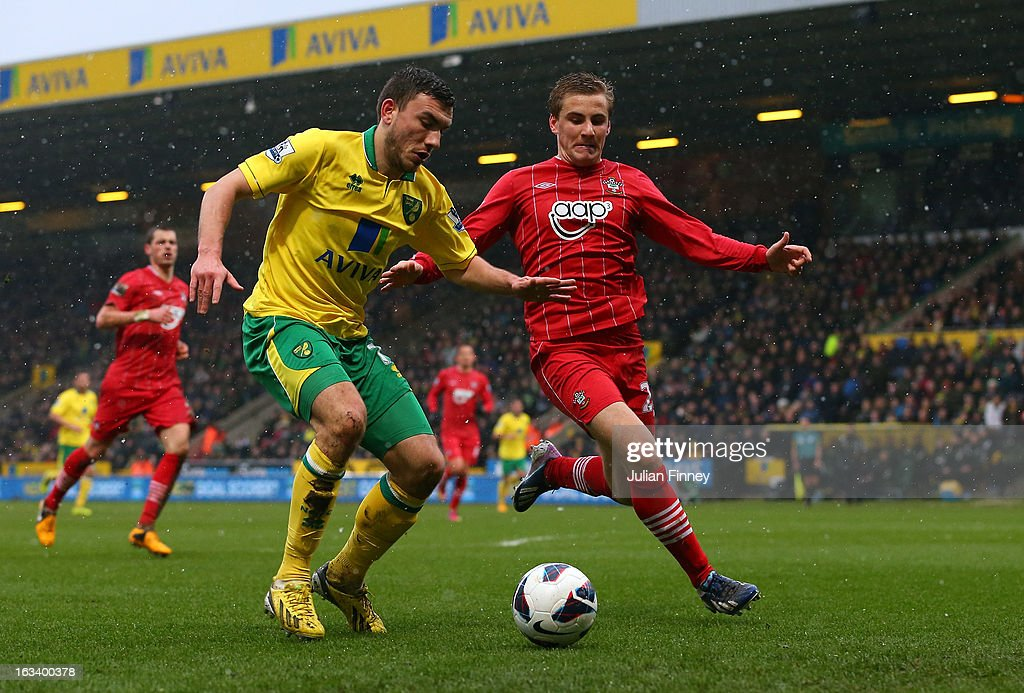 Robert Snodgrass of Norwich City battles with Luke Shaw of Southampton during the Barclays Premier League match between Norwich City and Southampton at Carrow Road on March 9, 2013 in Norwich, England.