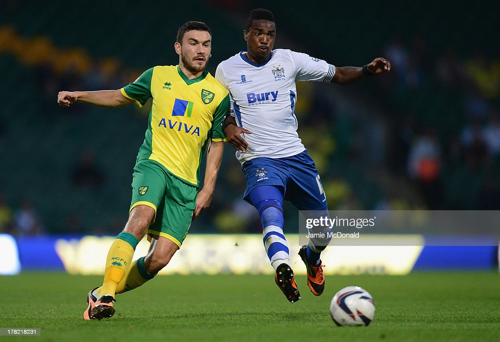 <a gi-track='captionPersonalityLinkClicked' href=/galleries/search?phrase=Robert+Snodgrass&family=editorial&specificpeople=5488953 ng-click='$event.stopPropagation()'>Robert Snodgrass</a> of Norwich City battles with Marlon Jackson of Bury during the Sky Bet League One match between Coventry City and Preston North End at Sixfields on August 25, 2013 in Northampton, England.