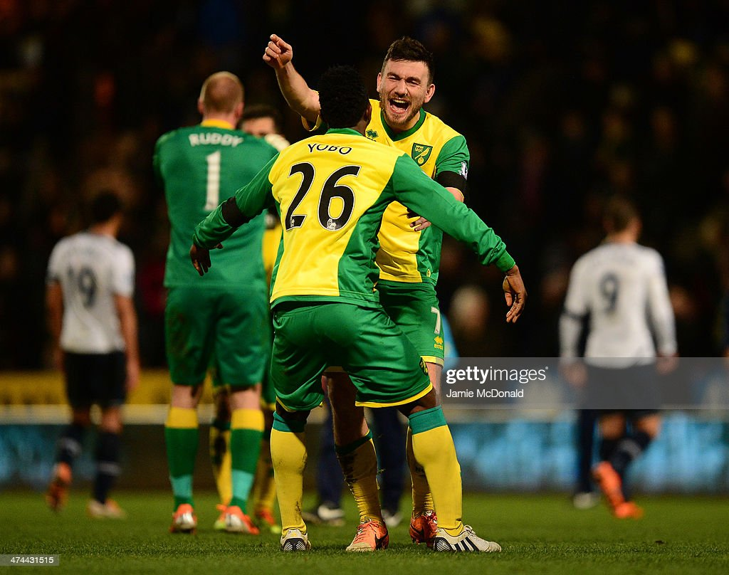 <a gi-track='captionPersonalityLinkClicked' href=/galleries/search?phrase=Robert+Snodgrass&family=editorial&specificpeople=5488953 ng-click='$event.stopPropagation()'>Robert Snodgrass</a> of Norwich City celebrates the 1-0 victory with <a gi-track='captionPersonalityLinkClicked' href=/galleries/search?phrase=Daniel+Sanchez+Ayala&family=editorial&specificpeople=6336746 ng-click='$event.stopPropagation()'>Daniel Sanchez Ayala</a> of Norwich City during the Barclays Premier League match between Norwich City and Tottenham Hotspur at Carrow Road on February 23, 2014 in Norwich, England.