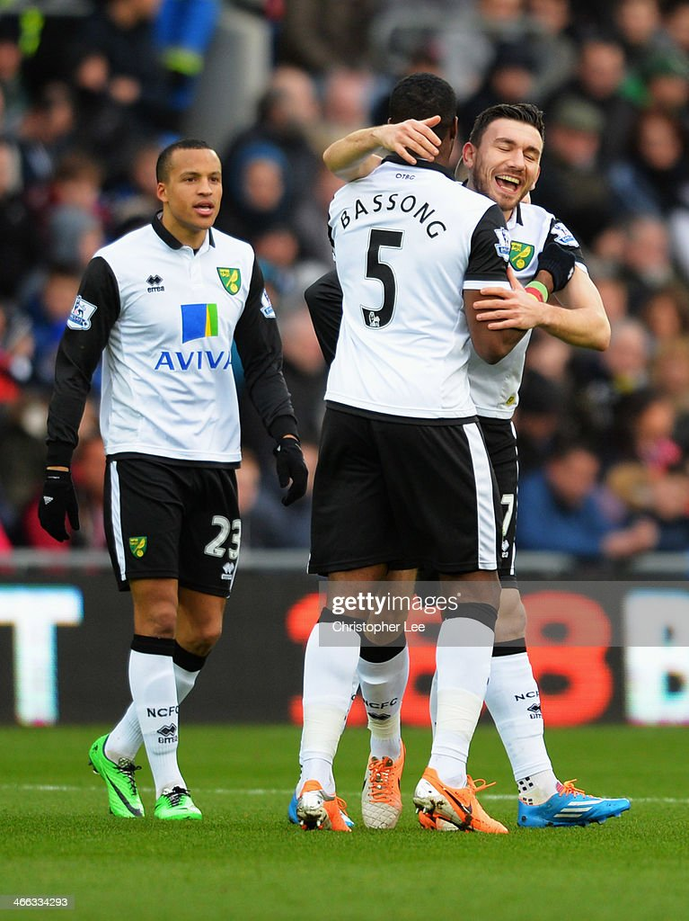 Robert Snodgrass of Norwich City celebrates with Sebastien Bassong as he scores their first goal during the Barclays Premier League match between...