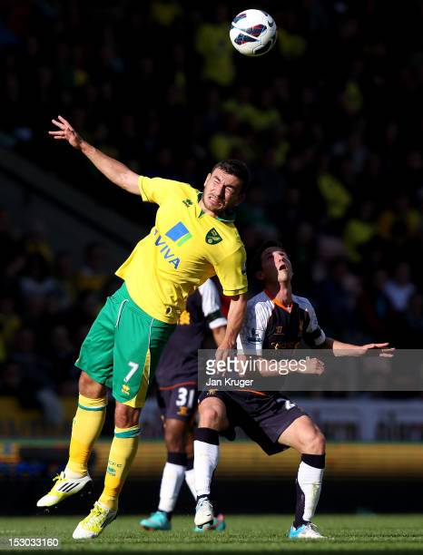 Robert Snodgrass of Norwich City competes for the arial ball during the Barclays Premier League match between Norwich City and Liverpool at Carrow...