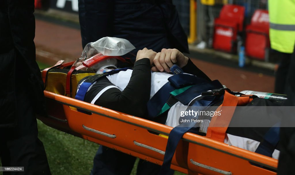 <a gi-track='captionPersonalityLinkClicked' href=/galleries/search?phrase=Robert+Snodgrass&family=editorial&specificpeople=5488953 ng-click='$event.stopPropagation()'>Robert Snodgrass</a> of Norwich City is stretchered off during the Capital One Cup Fourth Round match between Manchester United and Norwich City at Old Trafford on October 29, 2013 in Manchester, England.