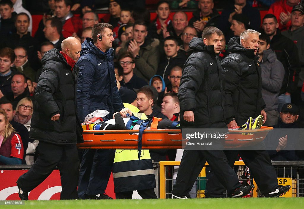 <a gi-track='captionPersonalityLinkClicked' href=/galleries/search?phrase=Robert+Snodgrass&family=editorial&specificpeople=5488953 ng-click='$event.stopPropagation()'>Robert Snodgrass</a> of Norwich City leaves the field on a stretcher during the Capital One Cup fourth round match between Manchester United and Norwich City at Old Trafford on October 29, 2013 in Manchester, England.