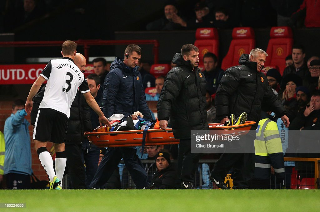Robert Snodgrass of Norwich City leaves the field on a stretcher during the Capital One Cup fourth round match between Manchester United and Norwich City at Old Trafford on October 29, 2013 in Manchester, England.