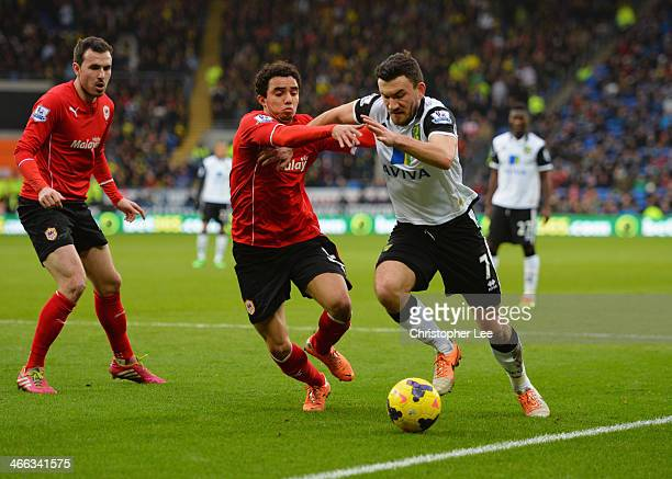 Robert Snodgrass of Norwich City takes on Fabio da Silva of Cardiff City during the Barclays Premier League match between Cardiff City and Norwich...
