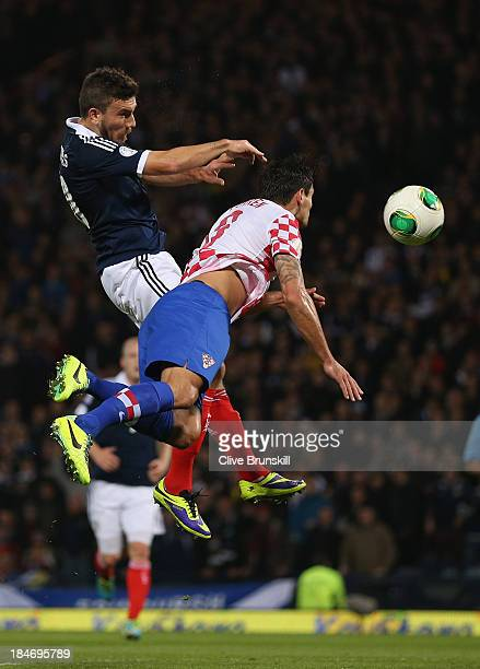 Robert Snodgrass of Scotland heads past Dejan Lovren of Croatia to score the first goal during the FIFA 2014 World Cup Qualifying Group A match...